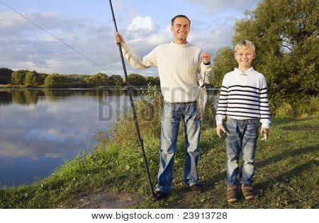 two fishermen in evening glow