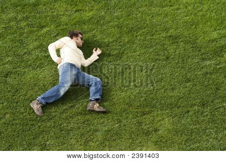 Running Laying Down On The Grass
