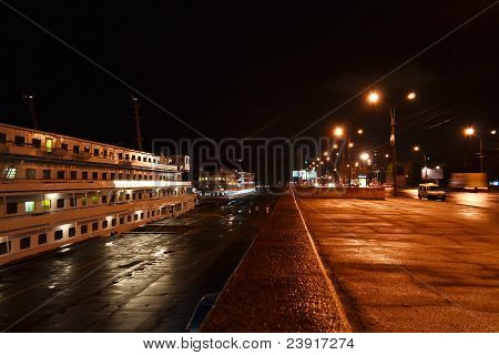 Night view of cruise boat and embankment