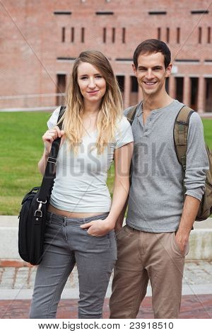 Portrait of a charming couple posing outside a building