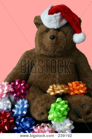 Christmas Teddy Bear Wearing Santa S Hat With Pink Background