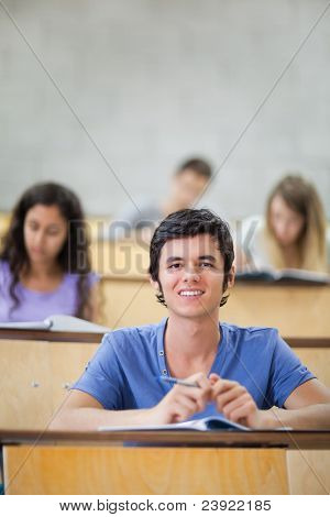 Portrait of focused students during a lecture with the camera focus on the foreground