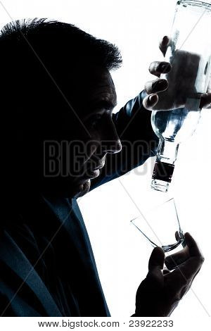 one caucasian man portrait silhouette drunk puring empty alcohol bottle in studio isolated white background