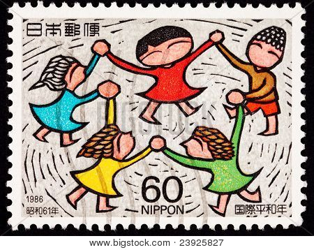 Canceled Japanese Postage Stamp Multicultural Children Holding Hands Spinning Dancing