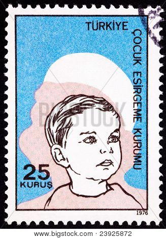 Canceled Turkish Postage Stamp Commemorating Social Services Boy Woman Silhouette