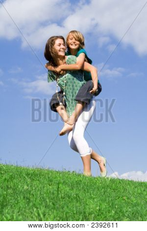 Family Piggyback Fun, Mother And Child