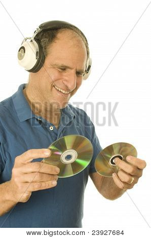 Middle Age Senior Man Listening To Music Through Classic Head Phones
