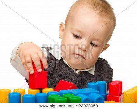 Little Boy Plays With Building Bricks