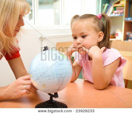 Little Girl At Geography Lesson
