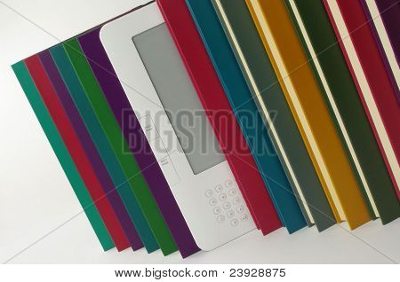 white e book and coloured books in a row