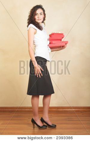 Businesswoman With Red Gifts