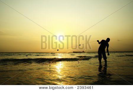 Fischfang auf Sonnenuntergang