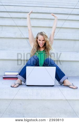 Successful Young Woman With Laptop