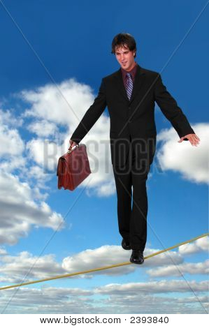 Businessman On Thightrope