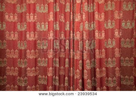 Red patterned curtains.