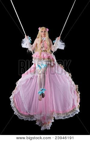 Pretty girl in fary-tale doll costume fly