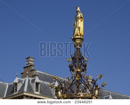 Gold statue on fountain, The Hague
