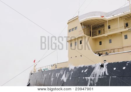 Icebreaker at sea in the snow