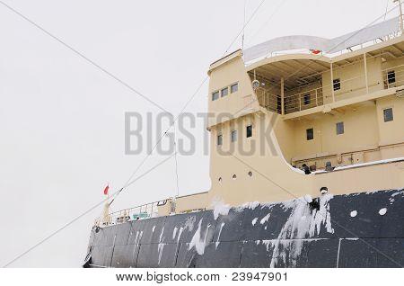 Icebreaker at sea in the snow