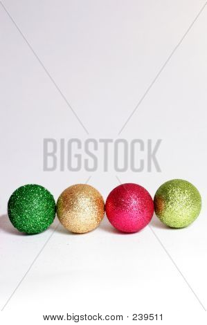 Four Glitter Baubles In A Row
