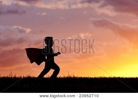 Boy Plays Super Hero At Sunset.