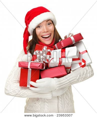Santa hat Christmas woman holding christmas gifts smiling happy and excited. Cute beautiful multi-racial Caucasian Asian santa girl isolated on white background.