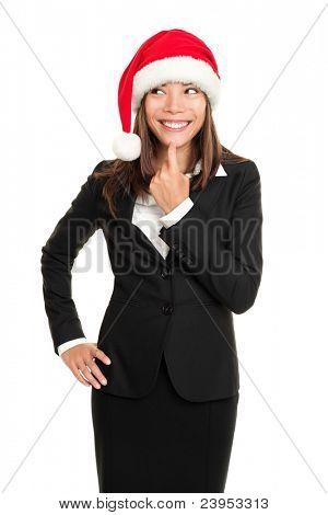 mujer de negocios de Navidad pensando mirando al lado usando santa sombrero y negocios traje. Multi-rac