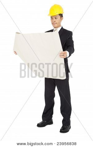 young architects holding a set of building plans isolated on a white background
