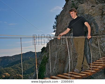 Man On Dangerous Hanging Bridge