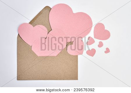 poster of Opened Envelope And Pink Paper Hearts. Valentines Day Envelope From Craft Paper And Decorative Heart