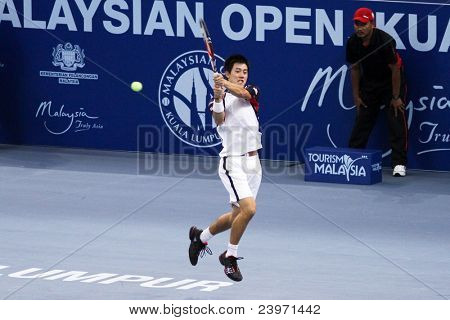 BUKIT JALIL, MALAYSIA- OCT 01: Japan's Kei Nishikori hits a backhand shot in this Malaysian Open semifinal match against Serbia's Janko Tipsarevic on October 01, 2011 in Putra Stadium, Bukit Jalil, Malaysia.