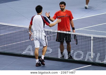 BUKIT JALIL, MALAYSIA- OCT 01::Serbia's Janko Tipsarevic (red) shakes the hands of Japan's Kei Nishikori after winning the Malaysian Open semifinal match on Oct 01, 2011 in Putra Stadium, Bukit Jalil, Malaysia.
