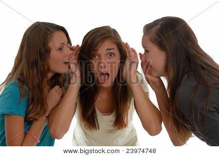 Teenage Girls Sharing Secrets One Is Shocked Others Whispering.