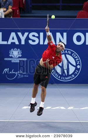 BUKIT JALIL, MALAYSIA - OCT 01: Cyprus' Marco Baghdatis serves in this Malaysian Open semi-final match with Serbia's Viktor Troicki on October 01, 2011 in Putra Stadium, Bukit Jalil, Malaysia.