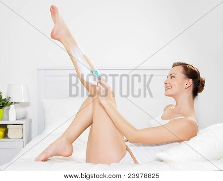 Woman Shaving Legs With Razor