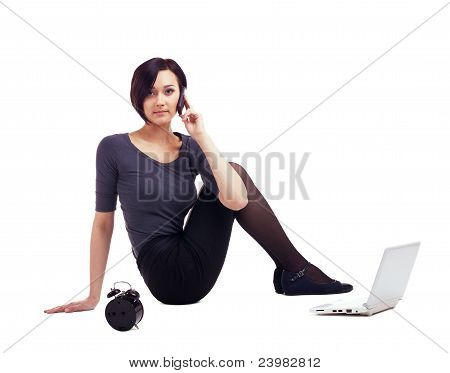 business woman sit with laptop talk on cell