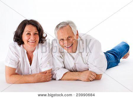 nice and happy couple lying on the floor