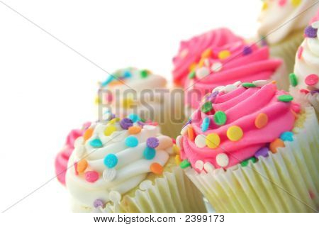 tilted plate of cupcakes on a white