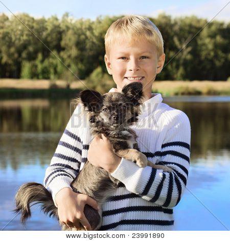 Happy boy with little dog. Focus on boy.