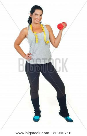 Slim Woman With Centimeter Holding Barbell
