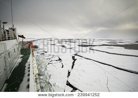 Research Icebreaker Cruising In Frozen