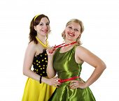 picture of poodle skirt  - two stylish young woman in bright colored dresses - JPG