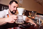 A Professional Barista Prepares Coffee Using An Alternative Method Of Brewing.drip Coffee Or Pour-ov poster