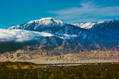 Beautiful Snow-covered Mount San Jacinto Rises Above The Coachella Valley And San Gorgonio Pass Wind poster