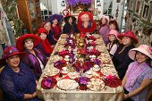 stock photo of party hats  - Twelve fashionable women sitting down for a tea party - JPG