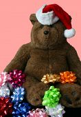 Christmas Teddy Bear Wearing Santa S Hat With Pink Background poster