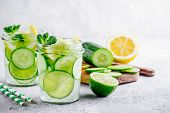 Infused Detox Water With Cucumber, Lemon And Lime. poster