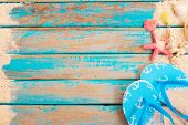 Beach Background - Top View Of Beach Sand With Shells, Starfish And Slipper On Wood Plank In Blue Se poster