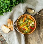 Bright Spring Vegetable Dietary Vegetarian Soup With Potatoes, Pepper, Carrot, Green Peas, Parsley.  poster