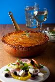 stock photo of ouzo  - baked moussaka dish on a wooden board - JPG